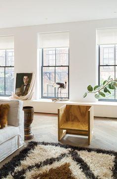 Living room interior design, neutrals, white, beige, brown, moroccan rug, art, wood