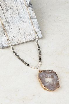 This jaw dropper of a necklace is a must! They won't last long and we have limited quantities. Gorgeous, electroplated druzy pendant with a mix of natural beads on chain. Chose your color by bead color… Grey or Brown.  Approx 30″  Stones all vary and no two are just alike. They are fairly large in size.