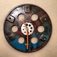 Clock made out of a old flywheel
