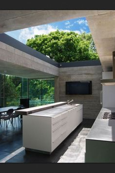 Open modern kitchen. love the concept of bringing the outside inside