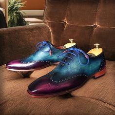 Paul Parkman Men's Wingtip Oxfords Blue & Purple Hand Painted Website: www.paulparkman.com #paulparkman #paulparkmanshoes #oxfords #goodyearwelted #oxfordshoes #mensoxfords #handmade #bespoke #luxury #shoemaker #handcrafted #shoesformen #mensshoes #handmadeshoes #handcraftedshoes #patinashoes #bespokeshoes #customshoes #luxuryshoes #luxuryshoemaker #bespokeshoemaker #mensluxuryshoes #luxurymenswear