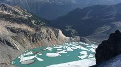 A mostly blue-green lake, captured in Aug. 17, 2014, photo, is in place of an icy white Decker Glacier.