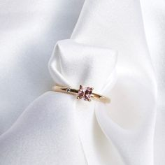 Princess Lucy Petite Ring with a peach pink tourmaline in 18K gold via mumbaistockholm. Click on the image to see more!