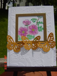 Sweetbriar rose ; Darice butterfly embossing folder ; Spellbinders Nest. Squares ; MS Monarch butterfly punch