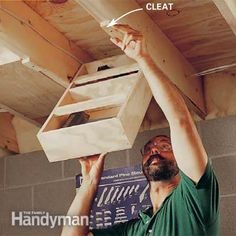 pivoting boxes that hang between the ceiling joists. When a drawer is down, you have easy access to its contents. Use glue and 1-5/8 in. drywall screws to hold together the boxes, then customize shelving for whatever you want to store. Make the width about 3/8 in. narrower than the cavity it fits in and use double-nutted 3/8 in. x 3-1/2 in. carriage bolts for the two pivot points.