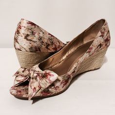 "Joan & David Peep Toe Printed Wedge Beautiful peep toe wedge with bow accent. This water color fabric features creams, tans, soft yellow, sage green and rose. 3"" heel wrapped in braided rope. EUC! Worn once Joan & David Shoes Wedges"