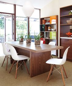 Mid Century Modern Dining Room. LOVE the look of these. Deciding if I am gutsy enough to order them for dining chairs.