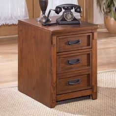 Signature Design by Ashley Cross Island File Cabinet - The Signature Design By Ashley Cross Island File Cabinet is a rustic design with mission detailing and mortise joints. This finely crafted office piec...
