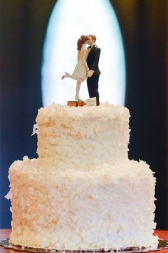 Coconut flake wedding cake with darling kissing cake topper! // image: Star Noir Studio