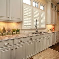 Sherwin Williams Amazing Gray paint color on cabinets.