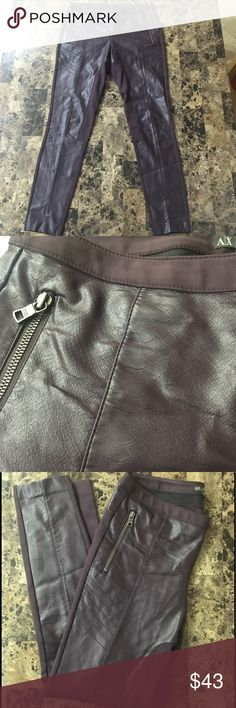 Armani Exchange sexy leather pant/leg Armani Exchange stunning leather pants, Stretchy leggings. Dark plum/maroon in color. Zippered pockets give these pants a cool edge! EUC condition, no issues! Thanks! Armani Exchange Pants Leggings