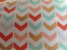 Handmade ruffled crib skirt made from subdued tones of teal, peach, and gold broken chevron design. The gold shines and this fabric is a very popular fabric this year. There is a slit on each side of the gathered crib skirt to make easy access for storage under the crib.    Extra ruffles or bows can be added, if desired, for a small additional fee.Custom orders available. | Shop this product here: spreesy.com/MyEclecticTreasure/41 | Shop all of our products at…