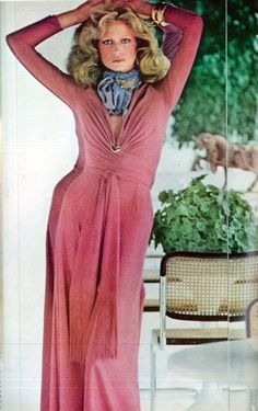 Vogue 1974 by Arthur Elgort red pink knit poly rayon gown long dress gathers ruching long sleeves model magazine color photo print ad designer early 70s maxi hostess