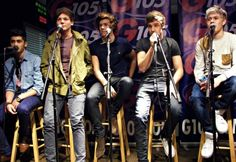 Doing what they do best. Looking hot and singing.