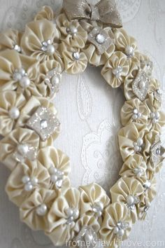 DSC_1311 Just made a YOYO wreath using a recycled wedding dress. Shimmer is great.