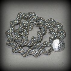 Silvery Twist ... Bead crochet necklace in four shades of silver.  Great for any occasion!  $ 89
