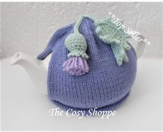 """The Cosy Shoppe """"top seller"""". Keeping teapots cosy around the world! Knitted Hats, Crochet Hats, Scottish Thistle, Tea Cozy, Knit In The Round, Crochet Flowers, Cosy, Hand Knitting, Lilac"""