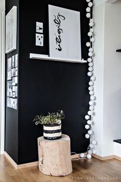 black and white wall. cotton ball lamp. design. home decor. decoration. interior