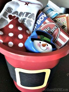 CHRISTMAS EVE SANTA BUCKETS Fill with pajamas, cocoa, popcorn, reindeer dust, a Christmas movie (or family game). You could even put a gingerbread house kit in it. Whatever helps your kids get excited for the next morning!