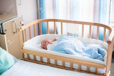 56545340-Newborn-baby-in-hospital-room-New-born-child-in-wooden-co-sleeper-crib-Infant-sleeping-in-bedside-ba-Stock-Photo.jpg (1300×866)