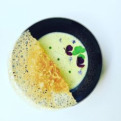 Asparagus cappuccino with basil oil and oxalis. #instafood #TheArtOfPlating…