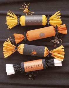 Toilet paper rolls with candy inside wrapped in tissue or crepe paper. Cute idea for school Halloween parties.