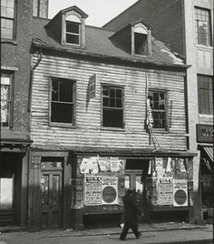"""This photo, taken in 1930, is from the MCNY archives, is captioned: """"Here lived Thomas Paine, who wrote The Age of Reason, which had much to do for the cause of the American Revolution. Built about 150 years ago. At Bleecker Street. Greenwich Village. Torn down Dec. 1, 1930."""""""