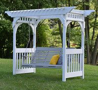 This swing arbor has an elegance that seems to speaks to an earlier age, but it's made of modern recycled poly products that will help it last for ages to come. #housetrends