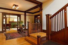 The entryway and the start of a gorgeous staircase in this 1915 restored Craftsman. (hookedonhouses.net)