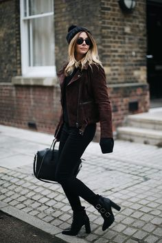 Emma Hill wears brown suede jacket, black sweater, skinny jeans, buckle heeled ankle boots, knitted bobble hat, Givenchy Antigona, winter outfit