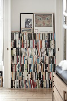 The owners of this period property in Glenageary stacked the books while they sought out a cool bookcase. However, they looked so good, they decided to leave them as they are!  Image Interiors & Living