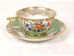 Porcelain cup signed Jacob Petit Paris, flowers and gilding