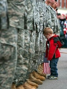 Son would not let go of dad the soldier before deployment.