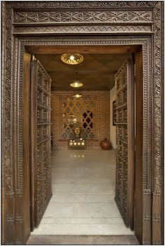 A modern bungalow using concrete, exposed brick design is designed and construced by KN Associates. Contemporary style architecture with use of kota stone. Pooja Room Door Design, Main Door Design, Brick Design, Gate Design, Best Interior Design, Bathroom Interior Design, Interior Ideas, Brick Feature Wall, Mandir Design