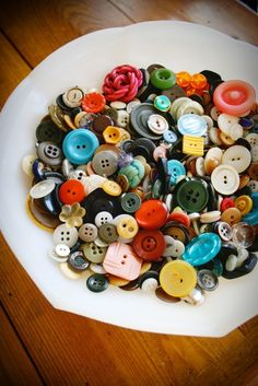Old buttons! We had a tin of these when I was growing up and they fascinated me. Many generations worth of buttons from salvaged garments and odds and bits and collectibles.