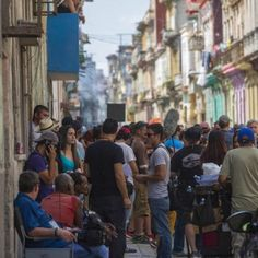 """The crew of the """"Fast and Furious"""" film work along Escobar street in downtown Havana, Cuba, Thursday, April 21, 2016. A part of the saga is being filmed in Havana, making it the first major Hollywood film to shoot in the country. (AP Photo/Desmond Boylan)"""