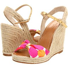 These Kate Spade wedges with pink and orange polka dots and a gold ankle strap look comfy AND cute.