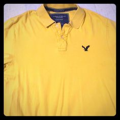 American Eagle cotton polo Men's American Eagle short sleeved cotton polo. Gently worn, and is wrinkled where the buttons are due to washing. No holes or rips. American Eagle Outfitters Tops
