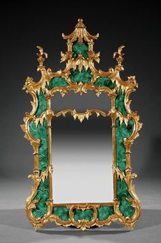 A Chinese Chippendale-Style Carved Giltwood and Malachite Mirror, foliate pagoda crest, mirror plate within C scroll surround, height 53 1/4 in., width 31 in.