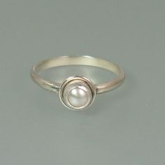 Simple modern pearl ring in sterling silver - perfect as a non-traditional diamond alternative pearl engagement ring or a pearl promise ring - Kryzia Kreations Jewelry  http://www.kryziakreationsstudio.com/products/modern-pearl-engagement-ring-in-sterling-silver  $95.00