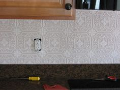 Fake-It Frugal: Fake Punched Tin Back splash. Raised, paintable wallpaper with a punched tin pattern. Martha Stewart's metallic paint in Polished Silver. Backsplash Wallpaper, Ceramic Tile Backsplash, Backsplash Cheap, Tin Tiles, Tin Ceiling Tiles, Kitchen Backsplash, Kitchen Cabinets, Kitchen Reno, Paintable Textured Wallpaper