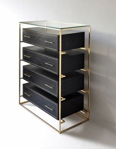 classy cubist chest of drawers in ebony and brass