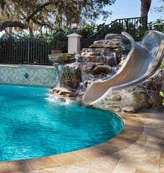 Pool Designs With Rock Slides pictures of 10 cool round rock pools oasis Custom Swimming Pool In Tanglewood Traditional With Natural Rock Built In Slide And