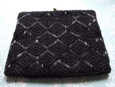 1960s Black Beaded Clutch Bag Hand Made in Hong Kong Approx 8 x 6 inches by brownmouse60 on Etsy https://www.etsy.com/listing/126850439/1960s-black-beaded-clutch-bag-hand-made