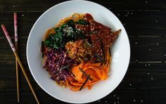 This Korean-inspired noodle bowl pays homage to bibimbap, a seasoned mixed rice and vegetable dish.