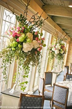 ♥ instead of giant centerpieces where you can't see the person across from you, have a giant hanging centerpiece <3