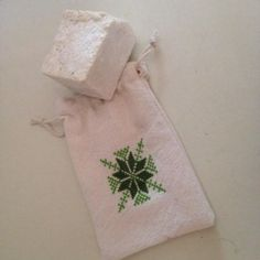 Palestinian handmade olive soap with embroidery cross stitch sachet. Price $8