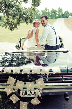 Bride and Groom Leave in Vinatge Convertible