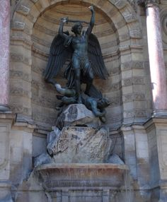 Here is a photo of the close up of the statue that stands within Fountaine Saint Michel which stands on rocks sculpted by Felix Saupin.  To see more go to www.eutouring.com