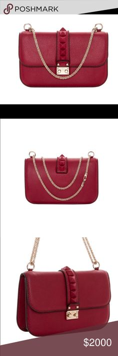 Valentino Rockstud Macro Stud Scarlet Shoulder Bag 💕Valentino Rockstud Macro Stud Scarlet Shoulder Bag Color options Scarlet Construction: Grainy leather Model: HWB00398 AVSJ01 L43 Exterior: Grainy leather, macro studs on flap Entry: Flap with push clasp closure Hardware: Pale goldtone Lining: Suede Handles: Chain strap Interior pockets: Double front flat pockets, rear zippered pocket Includes logo sleeper Made in Italy 6.5 inch tall x 10.75 inch wide x 3 inch deep Drop 12 inch as double…